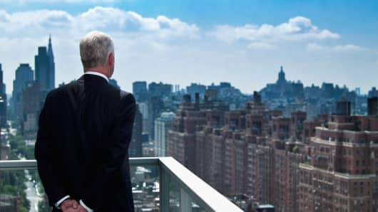 older man overlooking New York City, New york apartment, NYC apartment