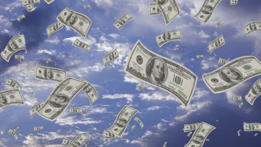 Hundred-dollar bills falling from sky