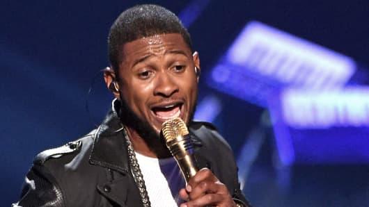 Usher performing
