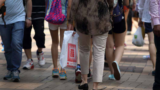 Pedestrians and shoppers walk in the Causeway Bay area of Hong Kong, China.