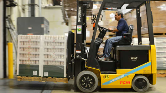 A forklift operator loads a semi-trailer with pallets of seasoning at the Badia Spices factory in Doral, Florida.