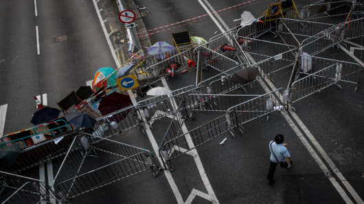 A man walks past a road block outside Hong Kong's Government complex in Hong Kong.