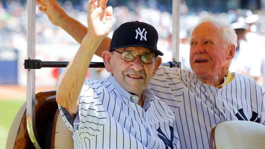 From left: Former New York Yankees and baseball Hall of Famers Yogi Berra and Whitey Ford were introduced during the teams 67th Old Timers Day prior to a game against the Tampa Bay Rays at Yankee Stadium in 2013.