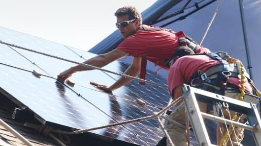 Installation of solar panels on a home in Park Ridge, Illinois.