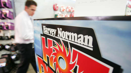 A customer walks through the showroom of a Harvey Norman store in Sydney.