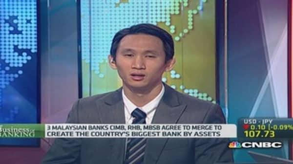Three-way merger creates Malaysia's banking giant