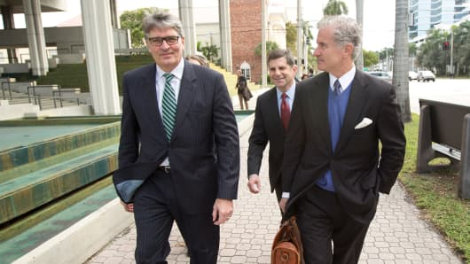 Raoul Weil, left, walks with his lawyer, David Mandel, after pleading not guilty to U.S. fraud charges, Jan. 7, 2014 in a Fort Lauderdale, Fla.