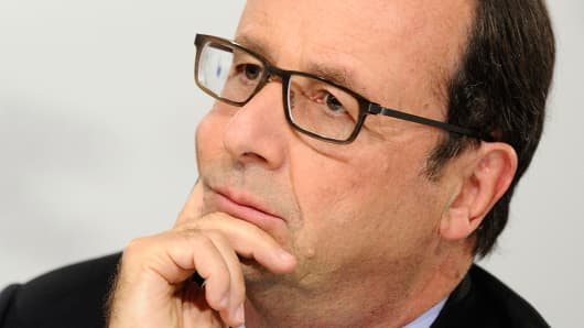 French President Francois Hollande looks on during a conference in Milan, Oct. 8, 2014.