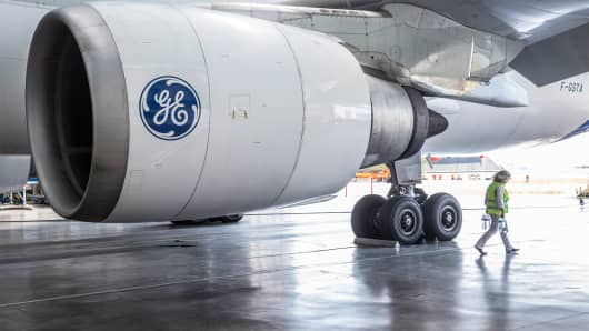 The General Electric logo on a GE Aviation CF6-80C jet engine as it hangs from the wing.