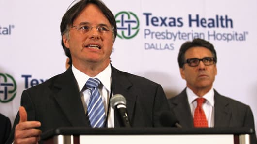 David L. Lakey (L), Commissioner of Texas Department of State Health Services, speaks at a media conference at Texas Health Presbyterian Hospital in Dallas, Texas, October 1, 2014.