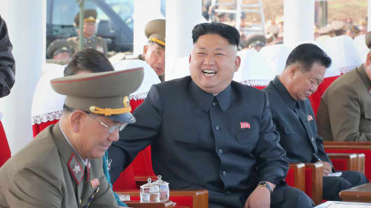 Kim Jong Un, center, watches an air show of the by the Korean People' s Air Force on May 10, 2014.