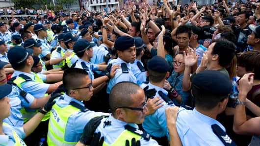 Scuffles break out between police and 'Occupy Central' protesters in front of Pacific Place shopping mall