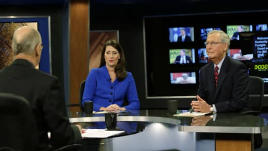 Minority Leader U.S. Sen. Mitch McConnell (R) and Kentucky Secretary of State Alison Lundergan Grimes (D) rehearse with host Bill Goodman before their debate on 'Kentucky Tonight' at the KET Network Center on October 13, 2014 in Lexington, Kentucky. Voters go to the polls on November 4, 2014.
