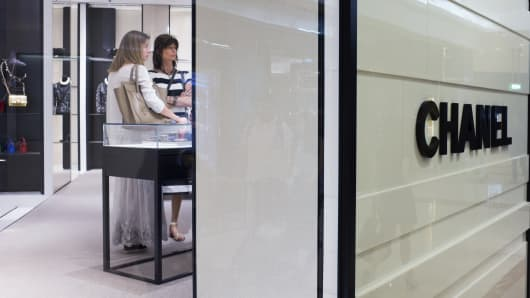 Customers look at merchandise in a Chanel SA store.