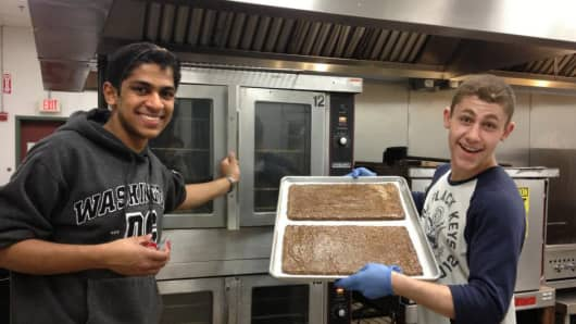Ali Kothari and Johnny Fayad cooking up a batch of their fair-trade coffee bars.