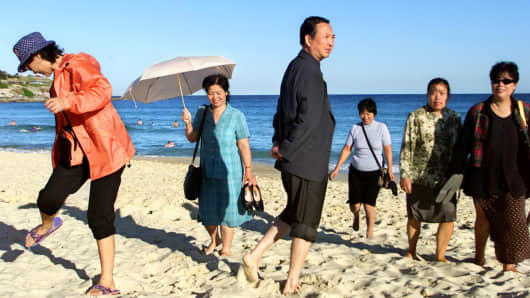 Chinese tourists enjoy the sands of Bondi Beach.