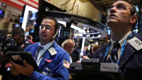 Traders work on the floor of the New York Stock Exchange (NYSE) on October 7, 2014 in New York City.