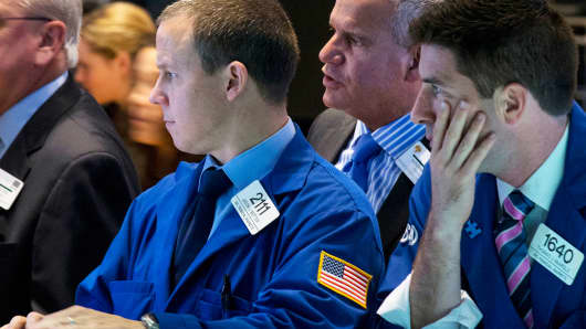 Traders on the floor of the New York Stock Exchange, October 15, 2014.