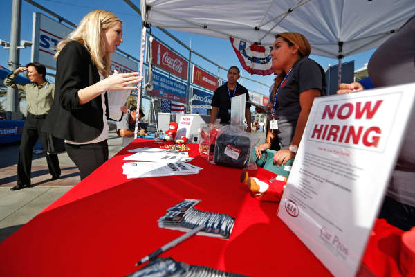 People browse booths at a military veterans' job fair in Carson, Calif., October 3, 2014.