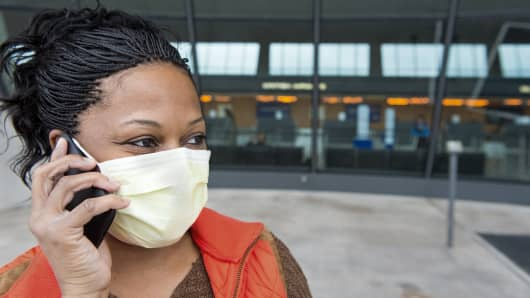 Twilette Miller, a nurse arrives from Dayton, Ohio, at Dulles International Airport Oct. 16, 2014, outside Washington, D.C.
