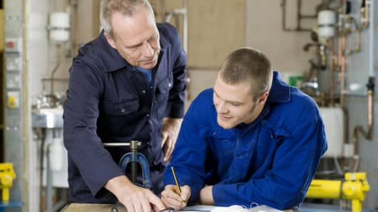 plumbers, father and son, family business, plumbing, older and younger man