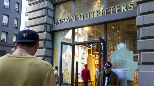 Pedestrians walk by an Urban Outfitters store in San Francisco.