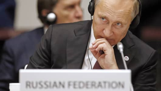 Russia's President Vladimir Putin attends the closing ceremony of the Europe-Asia summit (ASEM) in Milan, Oct. 17, 2014.