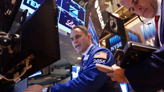 Traders work on the floor of the New York Stock Exchange, Oct. 17, 2014.