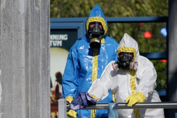 First responders wear full biohazard suits while responding to the report of a woman with Ebola-like symptoms at the Dallas Area Rapid Transit White Rock Station October 18, 2014 in Dallas, Texas.