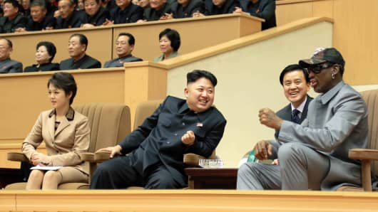 North Korean leader Kim Jong Un (2nd L) watches a basketball game between former U.S. NBA basketball players and North Korean players of the Hwaebul team of the DPRK with Dennis Rodman (R) at Pyongyang Indoor Stadium in this undated photo released by North Korea's Korean Central News Agency (KCNA) in Pyongyang January 9, 2014.
