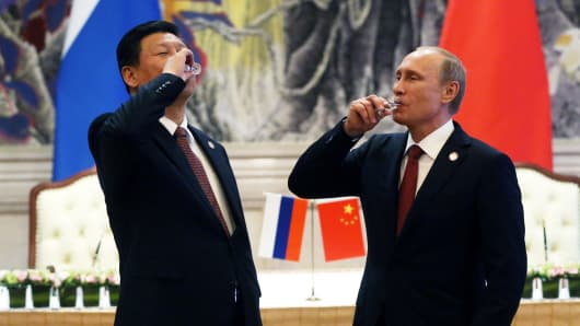 Russian President Vladimir Putin and Chinese President Xi Jinping toast during a signing ceremony on May 21, 2014, in Shanghai.