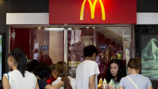 Customers order food at a McDonald's Corp. restaurant in the pedestrianized Dongmen area of Shenzhen, China.