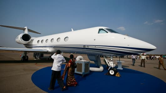File photo: Visitors look at a Gulfstream G450 aircraft at the India Aviation 2012 conference in Hyderabad, India,
