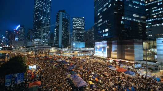 Tens of thousands of protesters gathered to listen to the talks between the government officials and the protesters tonight in the Admiralty district on October 21, 2014 in Hong Kong.