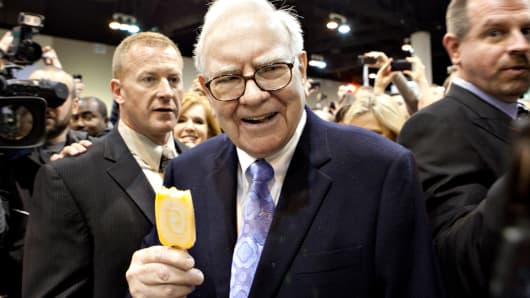 Warren Buffett eats a Dairy Queen ice cream bar prior to the Berkshire Hathaway annual meeting in Omaha, Nebraska.