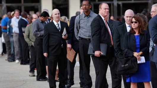 People wait in line to enter the Nassau County Mega Job Fair at Nassau Veterans Memorial Coliseum in Uniondale, New York, on Oct. 7, 2014.