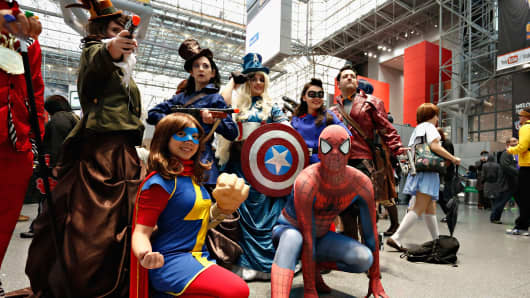 Costumed Comic Con attendees pose during New York Comic Con 2014 at Jacob Javitz Center on October 11, 2014 in New York City.