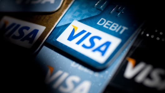 Visa credit and debit cards are arranged for a photograph in Washington.