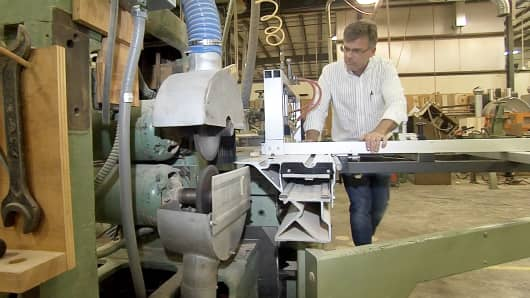Hardwood Artisans CEO Mark Gatterdam works in his manufacturing plant in Elwood, Va.