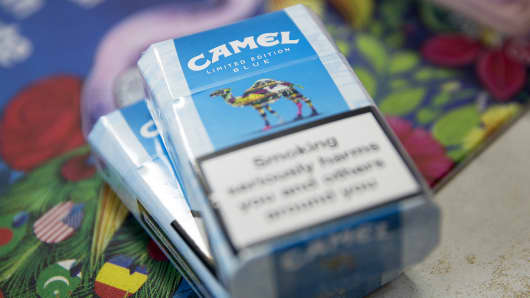 Packs of Camel cigarettes, manufactured by Reynolds American, are shown on a newsstand counter in London.