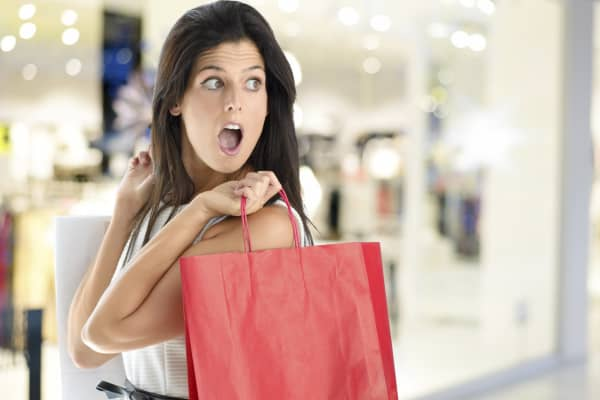 Woman horrified, shocked shopping woman, shopping woman, shopping