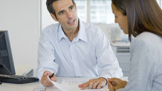 Financial advisor with female client