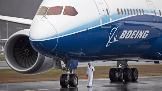 A Boeing ground test crew member examines a Boeing 787 Dreamliner.