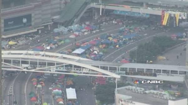 HK chief reaffirms unbending stance on reform