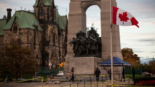 A flag flies at half-staff at the National War Memorial, where Cpl. Nathan Cirillo of the Canadian Army Reserves was killed yesterday while standing guard by a lone gunman, on October 23, 2014 in Ottawa, Canada