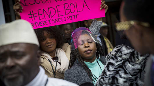 People participate in a march, organized by New York's West African community, to end Ebola, Oct. 24, 2014, in New York.