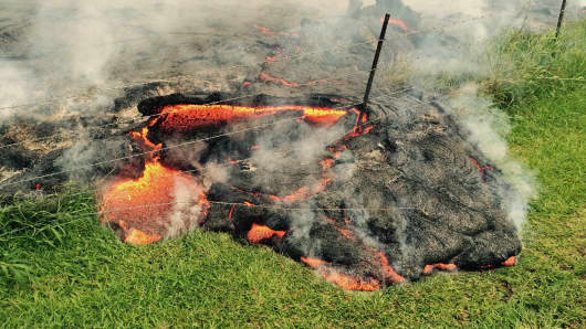 The lava flow from the Kilauea Volcano is seen advancing across a pasture between the Pahoa cemetery and Apa'a Street, in this U.S. Geological Survey (USGS) image taken near the village of Pahoa, Hawaii October 25, 2014.