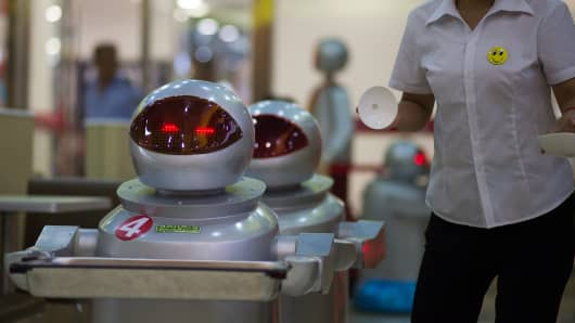 A robot carrying food to customers in a restaurant in Kunshan, China.