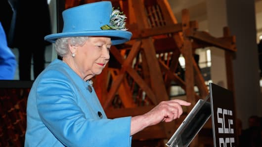 "Britain's Queen Elizabeth II sends her first Tweet during a visit to the ""Information Age"" exhibition at London's Science Museum in October"