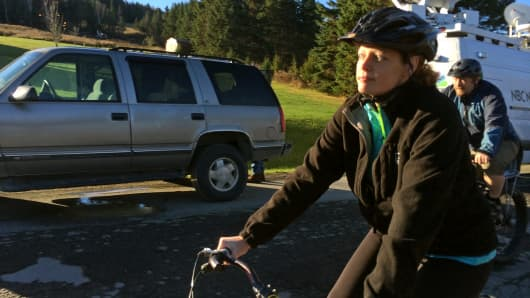 Nurse Kaci Hickox goes for a bicycle ride with boyfriend Ted Wilbur, Oct. 30, 2014.